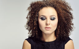 Young woman with curly hair with eyes closed Stock Photos