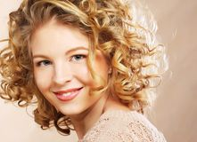 Young woman with curly hair Stock Photography
