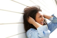 Young woman with curly hair smiling Royalty Free Stock Images