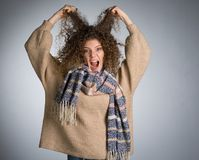 Young woman with curly hair. Studio Stock Photos