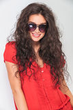 Young woman with curly hair wearing sunglasses. Stock Photo