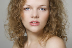 Young woman with curly hairs Royalty Free Stock Photography
