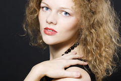 Young woman with curly hairs Royalty Free Stock Image