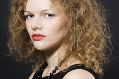 Young woman with curly hairs Stock Images
