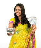 Young woman with currency notes. Beautiful young woman with currency notes royalty free stock image