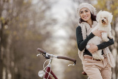 Young woman with a cute dog Royalty Free Stock Image