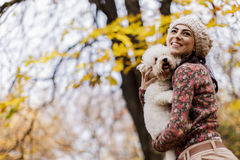 Young woman with a cute dog Royalty Free Stock Photo