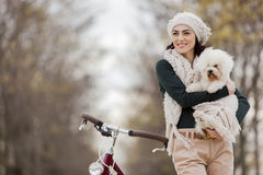 Young woman with a cute dog Stock Images