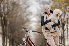 Young woman with a cute dog Royalty Free Stock Photography