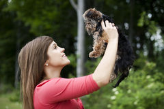 Young woman with cute puppy Royalty Free Stock Photography