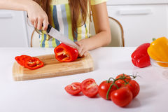 Young woman cutting fresh vegetables Stock Photo