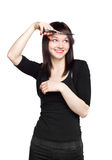 Young woman cutting her fringe. Over white background Royalty Free Stock Photography