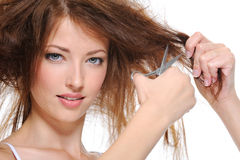 Young woman cutting her hair Royalty Free Stock Photography