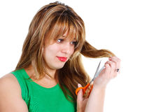 Young woman cutting her hair Stock Photography