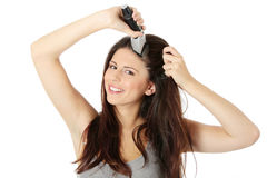 Young woman cutting her long hairs Stock Photography