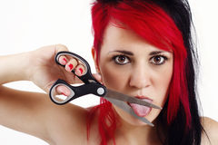 Young woman cutting her tongue with scissors Stock Images