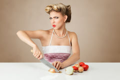 Young woman cutting onion Stock Photo