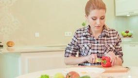 Young woman cutting paprika stock video