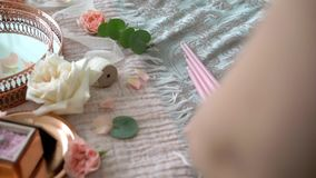 Young woman cutting pink ribbon and decorate candles. For wedding stock footage