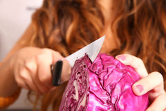 Young woman cutting red Cabbage Stock Image