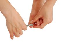 Young Woman Cutting Toenail Stock Photo