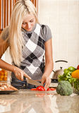 Young Woman Cutting Tomato Stock Photos