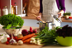 Young woman cutting vegetables in the kitchen.  Royalty Free Stock Photo