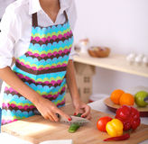 Young woman cutting vegetables in kitchen Royalty Free Stock Photography