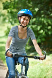 Young Woman Cycling Along Country Road Stock Photography