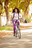 Young Woman Cycling Along Street To Work Royalty Free Stock Photo