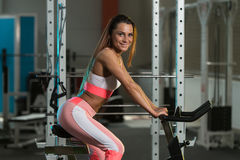 Young Woman Cycling On Bike Bodybuilding Training Royalty Free Stock Photos