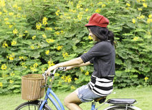 Young woman cycling and having fun Royalty Free Stock Image