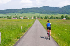 Young woman cycling in the hills Royalty Free Stock Photos