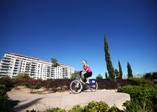 Young woman cycling in the park Royalty Free Stock Photography