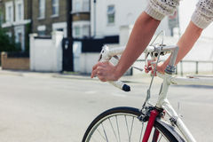Young woman cycling on a road in the city Royalty Free Stock Images