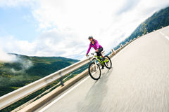 Young Woman Cycling Royalty Free Stock Images