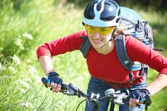 Young woman cyclist in the park Stock Image