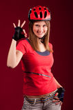 Young woman cyclist shows OK Stock Photos