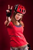 Young woman cyclist with victory fingers Stock Photo