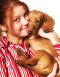 Young woman with a dachshund Royalty Free Stock Photos