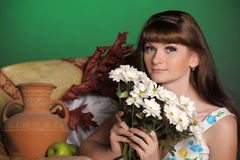 Young woman with daisies Stock Photos
