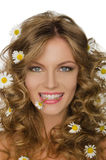 Young woman with daisies in hair and teeth Royalty Free Stock Photography