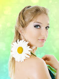 Young woman with daisy flower stock images
