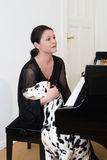Young woman with dalmatian dog Royalty Free Stock Image