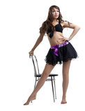 Young woman dance with chair in sexy dress Royalty Free Stock Photo