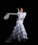 Young woman dance in white flamenco costume Stock Photos