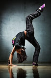 Young woman dancer. On wall background Royalty Free Stock Photos