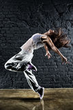 Young woman dancer. On wall background stock images