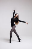 Young woman dancer in black swimsuit posing Stock Photography