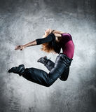 Young woman dancer jumping royalty free stock photos